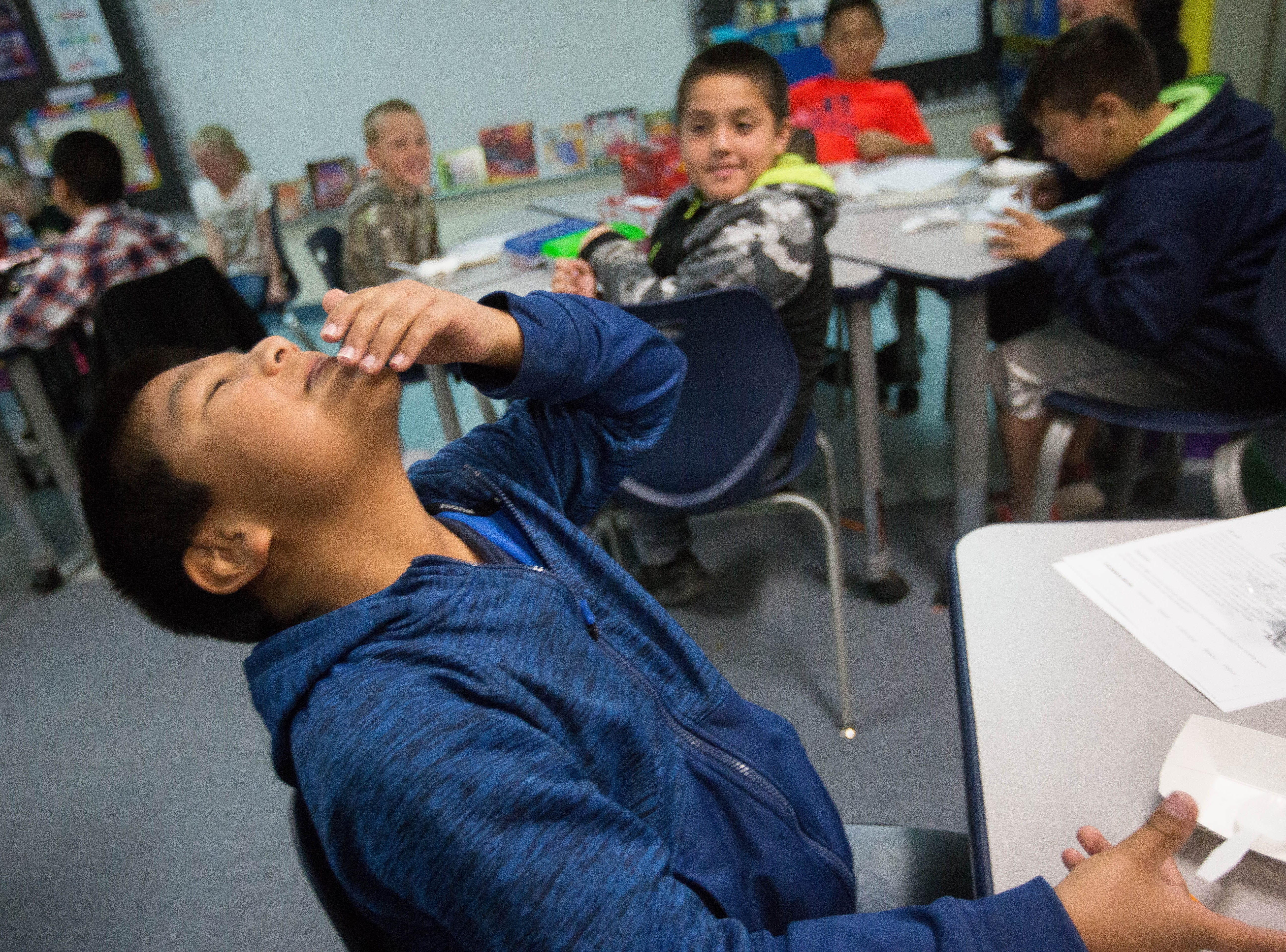 Rogelio Torres, 9, reacts to the taste of lentils during a nutrition class in Ashley Cartwright's home room at East Picacho  Elementary School, Thursday, November 29, 2018.