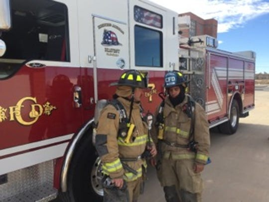 Rookie firefighters discuss strategy Nov. 29, 2018, during a Carlsbad Fire Department training exercise at the Eddy County Fire Service south of Carlsbad.