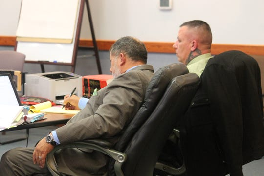 Jason Krcelic, right, and his defense attorney Louis Lopez listen to testimony during his trial in 12th Judicial District Court Wednesday.