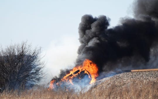 Fire engulfs an SUV after a rollover accident on U.S. 287 about 5 miles north of Bowie, Texas, Jan. 17, 2018. Maj. Justin Warner, a 97th Flying Training Squadron introduction to fighter fundamentals instructor at Sheppard Air Force Base, Texas, was awarded the Airman's Medal Nov. 27, 2018, for heroism when he pulled retired Air Force Lt. Col. Stephen Wolfe and his daughter from the vehicle moments before the fire had spread.