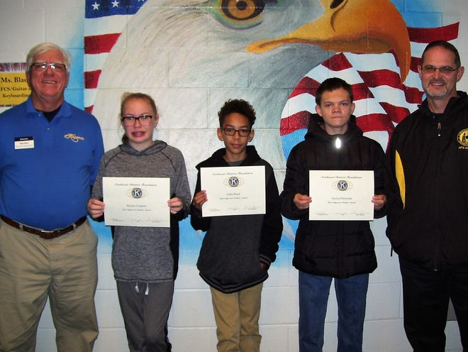 From left are Ned Kline of Kiwanis,  seventh grader Baylee Lundeen,  sixth grader Gabe Black,  eighth grader Jayson Perryman and Principal Steven Starkovich. Lundeen, Black and Perryman were honored as Kiwanis Club's Most Improved Students of the Month for November.