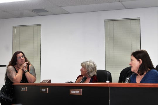 Otero County Commission Chairwoman Lori Bies, left, contemplates possibilities for an official county flag while Commissioner Janet White, center, and Commission Chairwoman Susan Flores discuss flag possibilities.