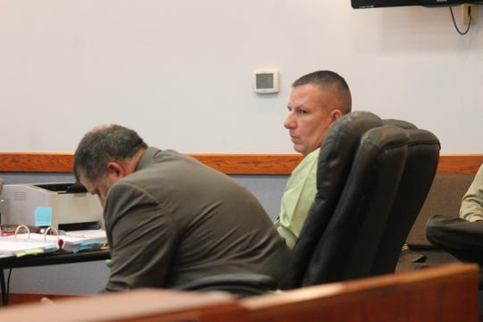 Jason Krcelic, left, and his defense attorney Louis Lopez wait for testimony to resume during a break in his trial Wednesday.