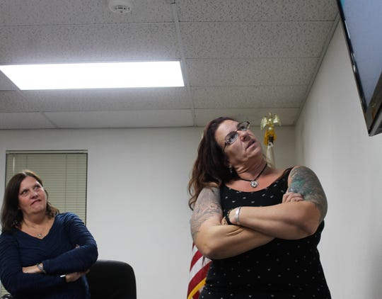 Otero County Commission Vice Chairwoman Susan Flores, left, and Commission Chairwoman Lori Bies, right, discern ideas for an official county flag at a public hearing Thursday.