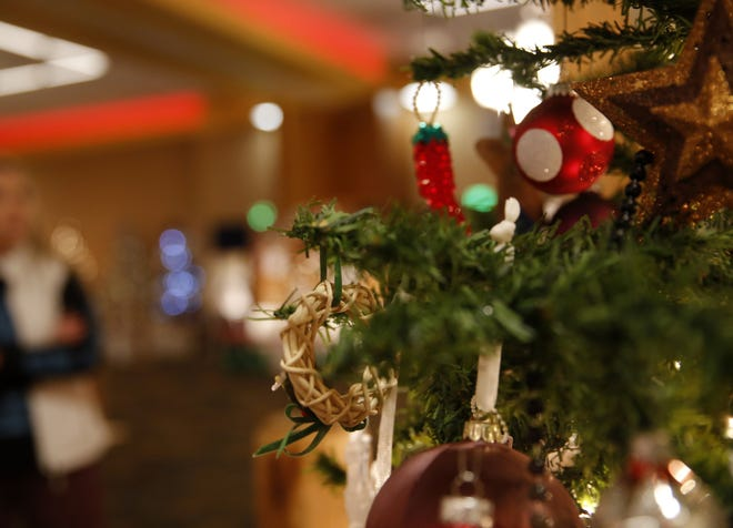 Ornaments adorn a Christmas tree displayed at Festival of Trees, Wednesday, Nov. 28, 2018, at the Farmington Civic Center.