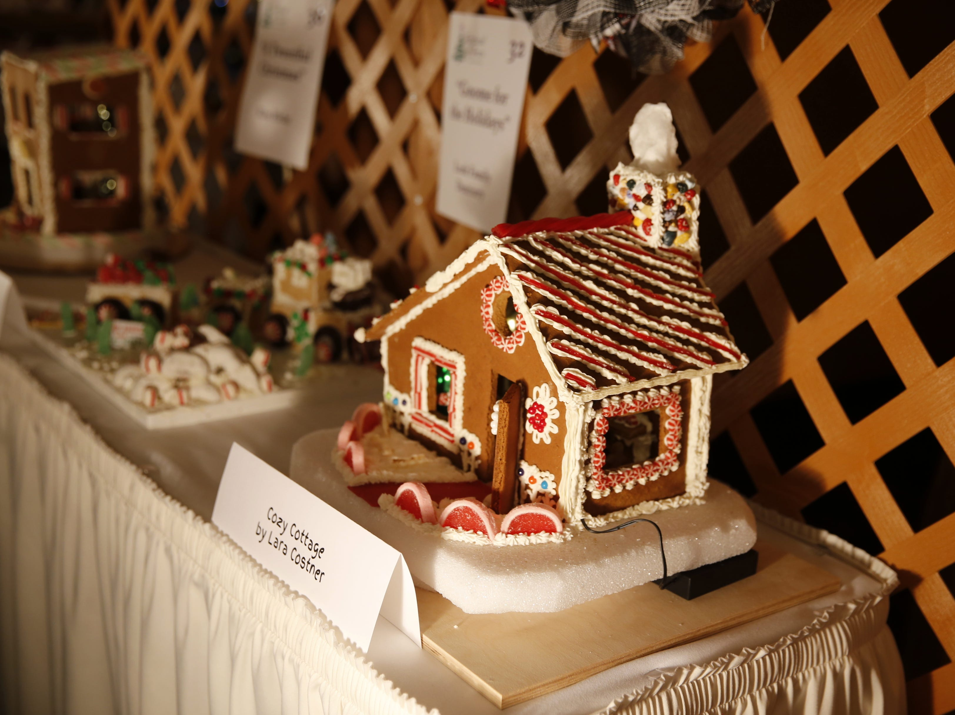 A gingerbread house is displayed on a table, Wednesday, Nov. 28, 2018, during Festival of Trees at the Farmington Civic Center.