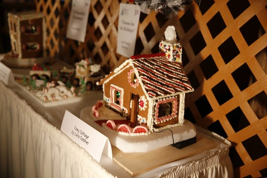 A gingerbread house is displayed on a table Wednesday during the Festival of Trees at the Farmington Civic Center.