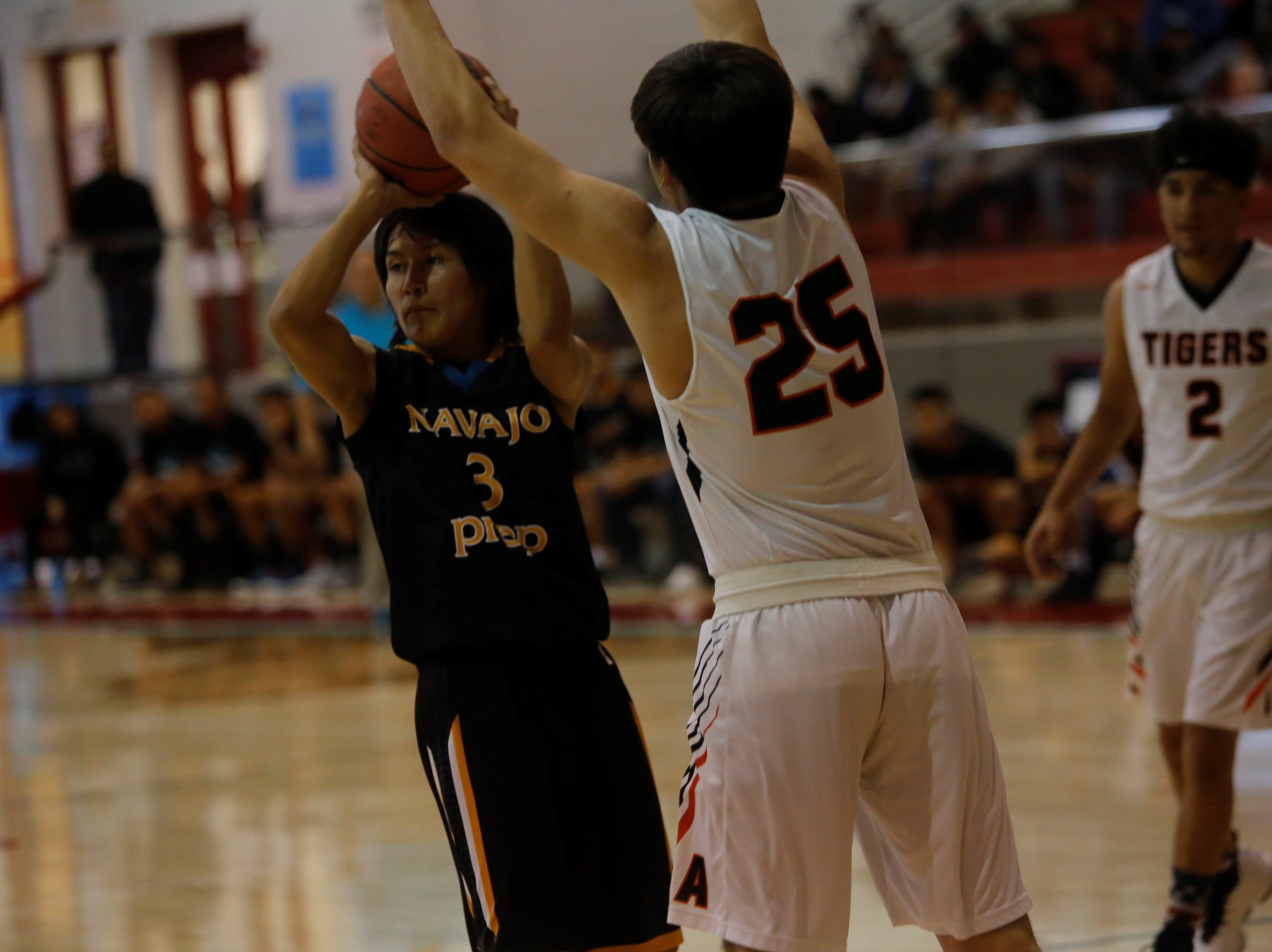 Navajo Prep's Cody Manning passes the ball down the right side against Aztec during the Jerry Richardson Memorial tournament Thursday at Shiprock.