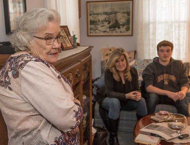 Mildred Davis talks about her life. In background, daughter Lori Leach and grandson John Ellis.