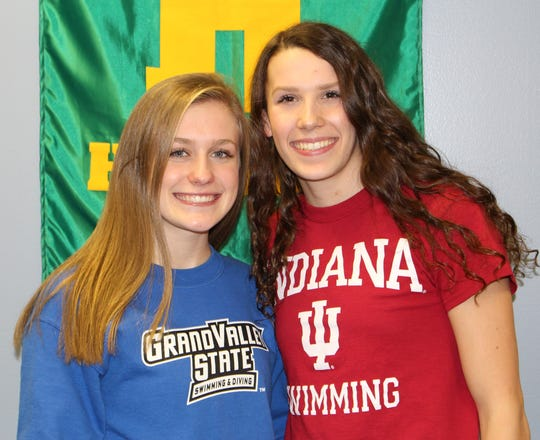 Harrison-Farmington swim standouts Dayna Borregard (left) and Ashley Turak are headed to Grand Valley State and Indiana, respectively.