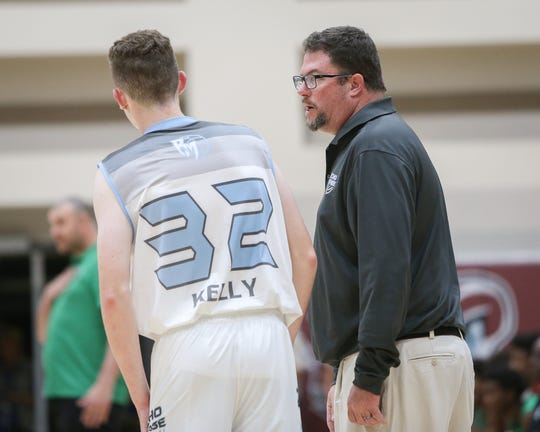 Rancho Mirage basketball coach Rob Hanmer discussed a play with Grant Kelly Wednesday night. Hanmer won his 409th career game, the most ever for a desert coach.