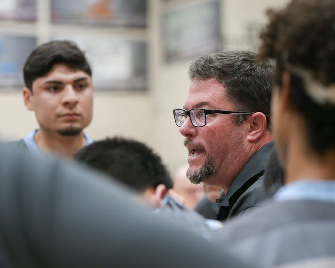 Rancho Mirage basketball coach Rob Hanmer gets serious during a huddle on Wednesday night. He won his 409th career game, the most ever for a desert coach.
