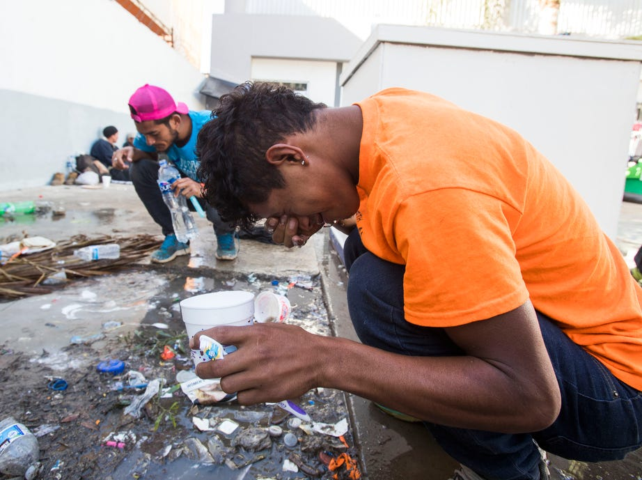 Migrants wash their face and brush their teeth at the only water station in the Benito Juarez sports complex shelter. The shelter had a maximum capacity of housing 3000 and is currently housing 5851 migrants inside the sports complex turned shelter in the city of Tijuana, Mexico on November 27, 2018.