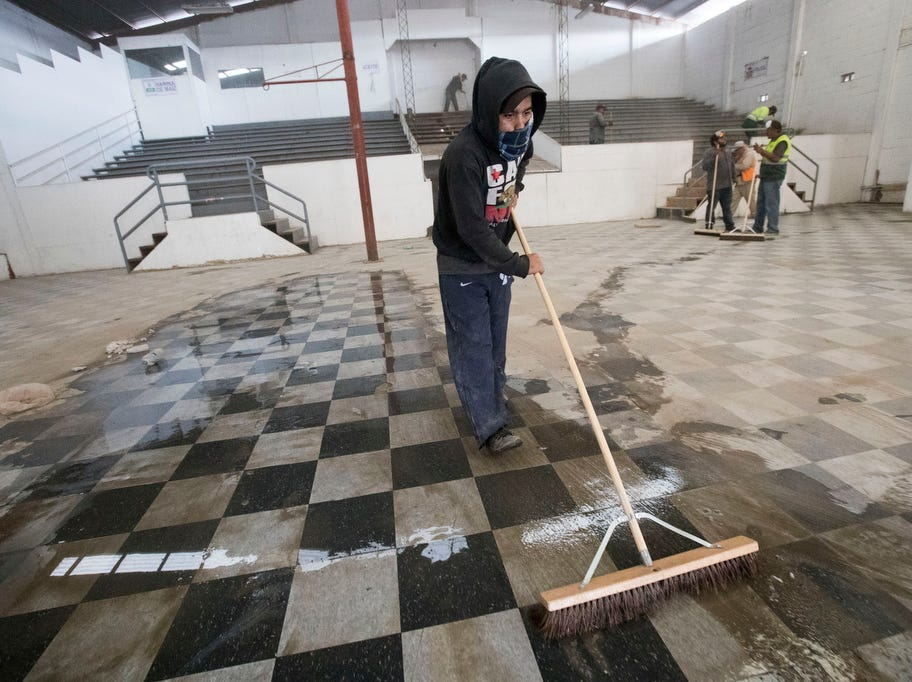 Crews clean up a building where a second shelter may be opened for the caravan migrants on November 28, 2018. The 5000 migrants are currently housed in the Benito Juarez sports complex which had a maximum capacity of 3000. If the migrants agree to move to the new shelter, they would be moved 11 kilometers from the San Ysidro Port of Entry.