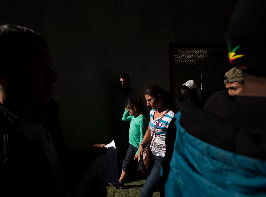 Migrants from Honduras arrive to look for work during a job fair provided by the Tijuana municipal government for those migrants wishing to remain in Tijuana, Mexico on November 27, 2018.