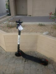 A Bird scooter behind the Kimpton Rowan Palm Springs