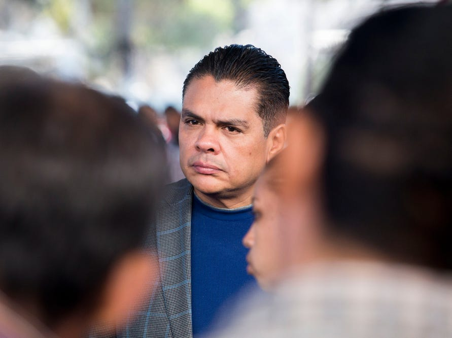Honduran ambassador to Mexico, Alden Rivera Montes, listens to his compatriots during a job fair provided by the Tijuana municipal government for those migrants wishing to remain in Tijuana, Mexico on November 27, 2018.