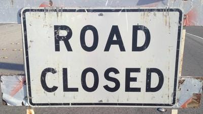 "A ""road closed"" sign."