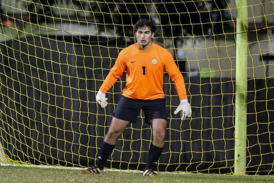 Catholic's Mack Hamrick (1) watches the play develop in front of him during the game against West Florida at Catholic High School on Wednesday, November 28, 2018.