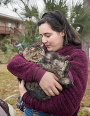 Chloe Ward, 16, cuddles her cat Sokka after coming home from school in Gulf Breeze on Thursday, November 29, 2018.  Sokka, who has been missing since a fire destroyed the Ward apartment, was found earlier in the day by Ryan when he stopped by to search for him among the ruin.