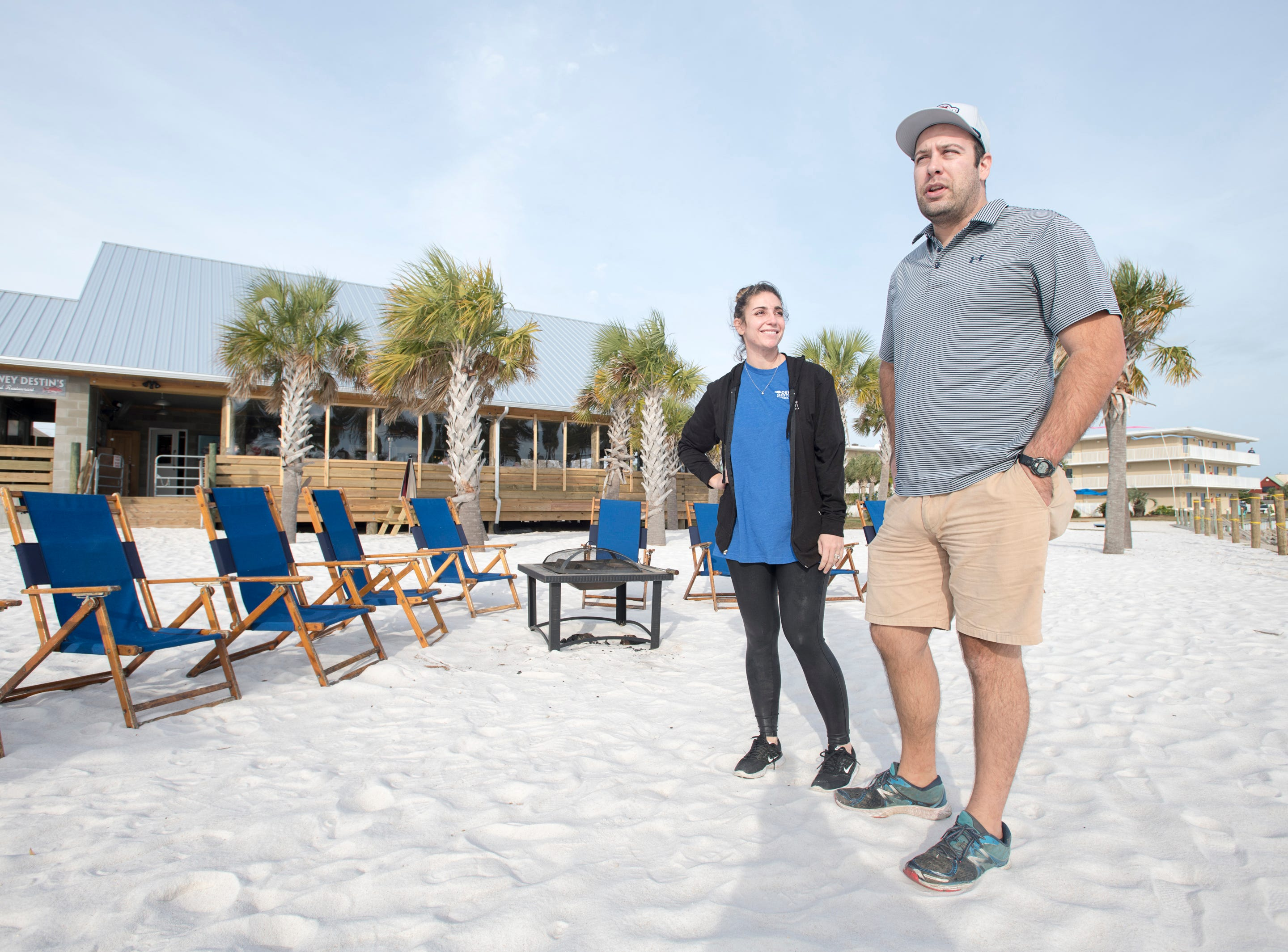 Co-owners Cameron Destin-Ayres, left, and Parker Destin talk about the backyard at their new Dewey Destin Seafood Restaurant in Navarre on Thursday, November 29, 2018.