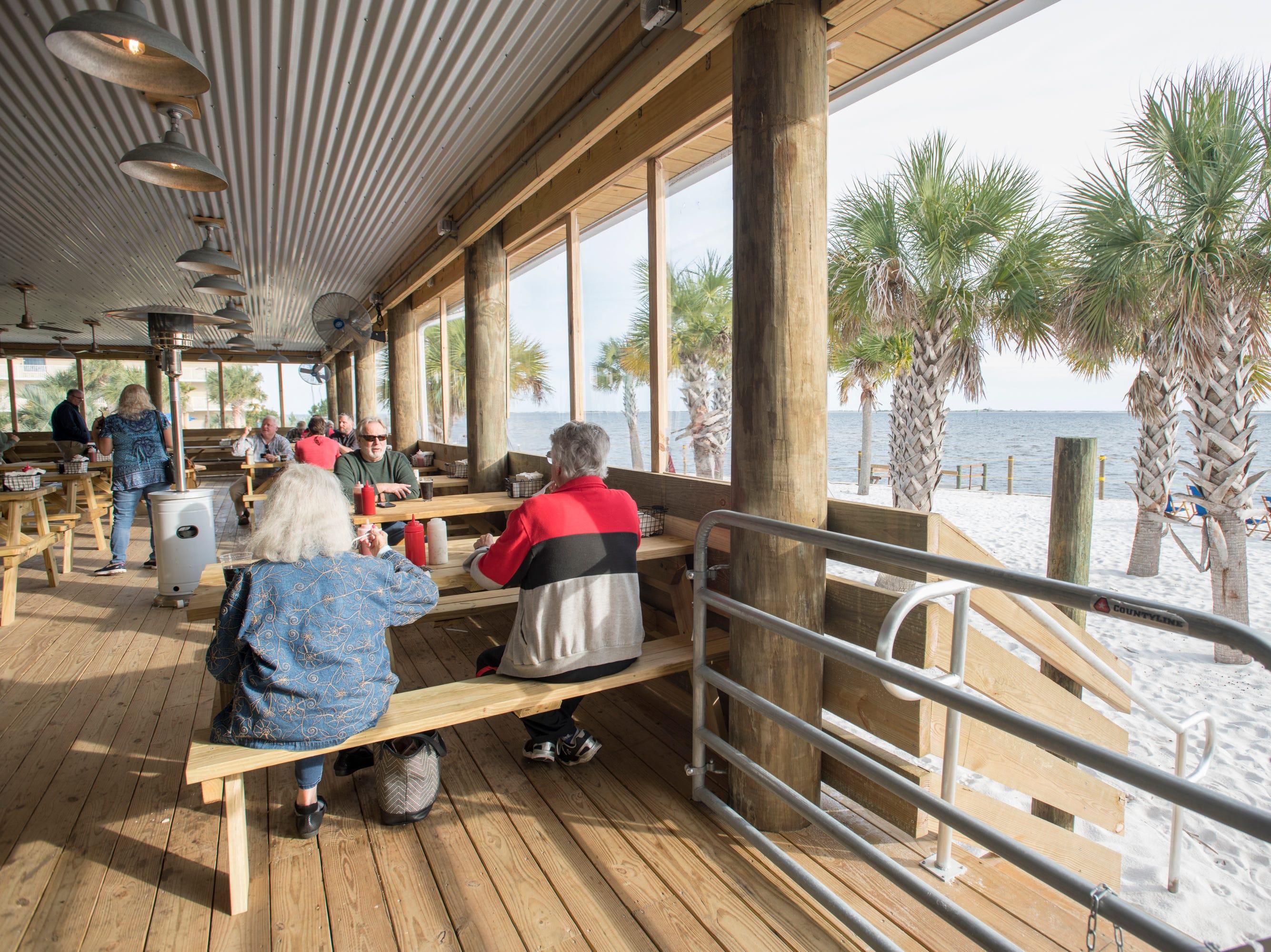 The dining room overlooks Santa Rosa Sound at the new Dewey Destin Seafood Restaurant in Navarre on Thursday, November 29, 2018.