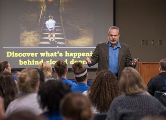 Brad Dennis, national search director for the KlaasKIDS Foundation's Search Center for Missing and Trafficked Children, talks to health care workers Thursday about how to identify victims of human trafficking and commercial sex exploitation during a seminar at Baptist Hospital in Pensacola.