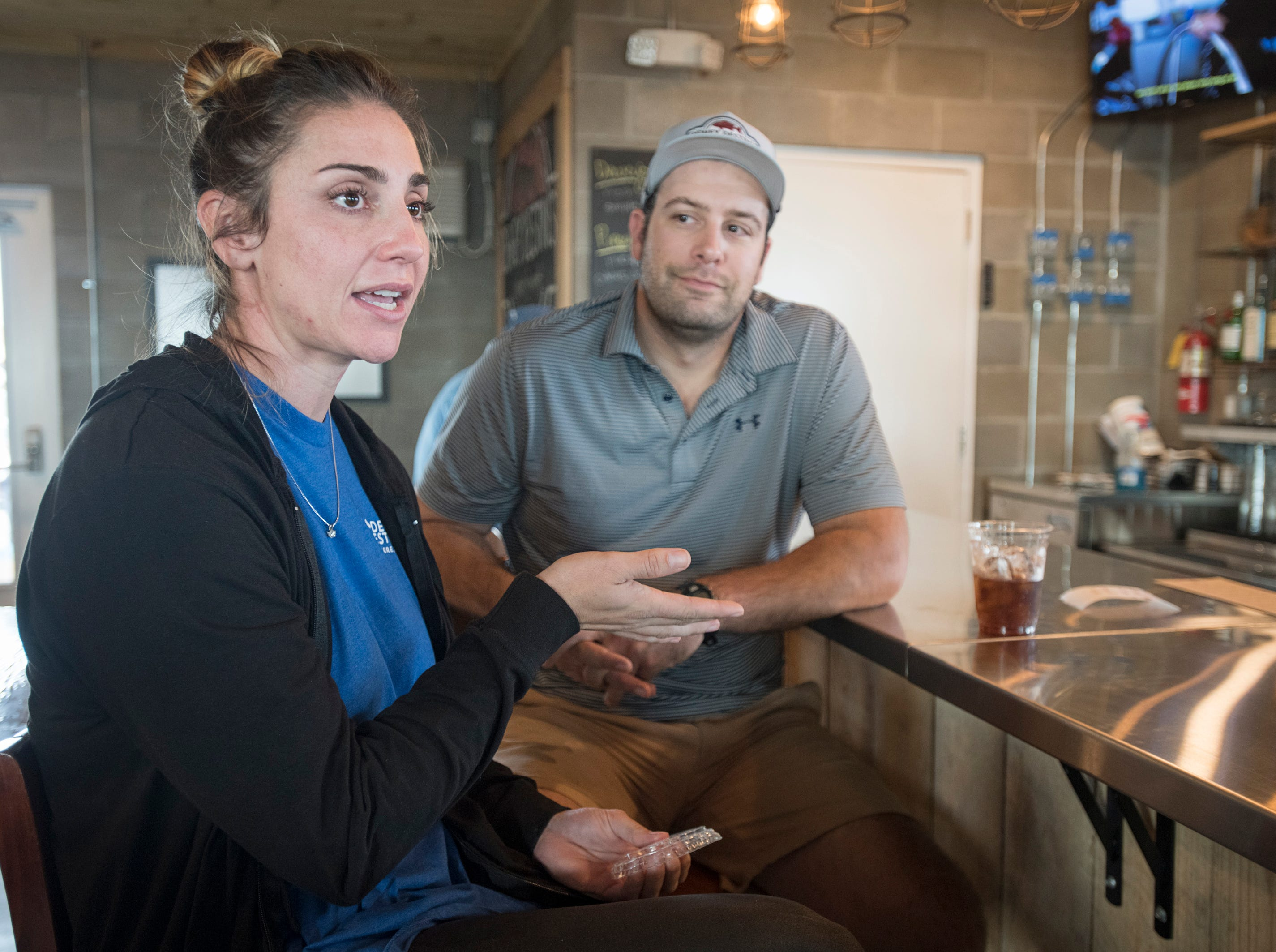 Co-owners Cameron Destin-Ayres, left, and Parker Destin talk about their new Dewey Destin Seafood Restaurant in Navarre on Thursday, November 29, 2018.