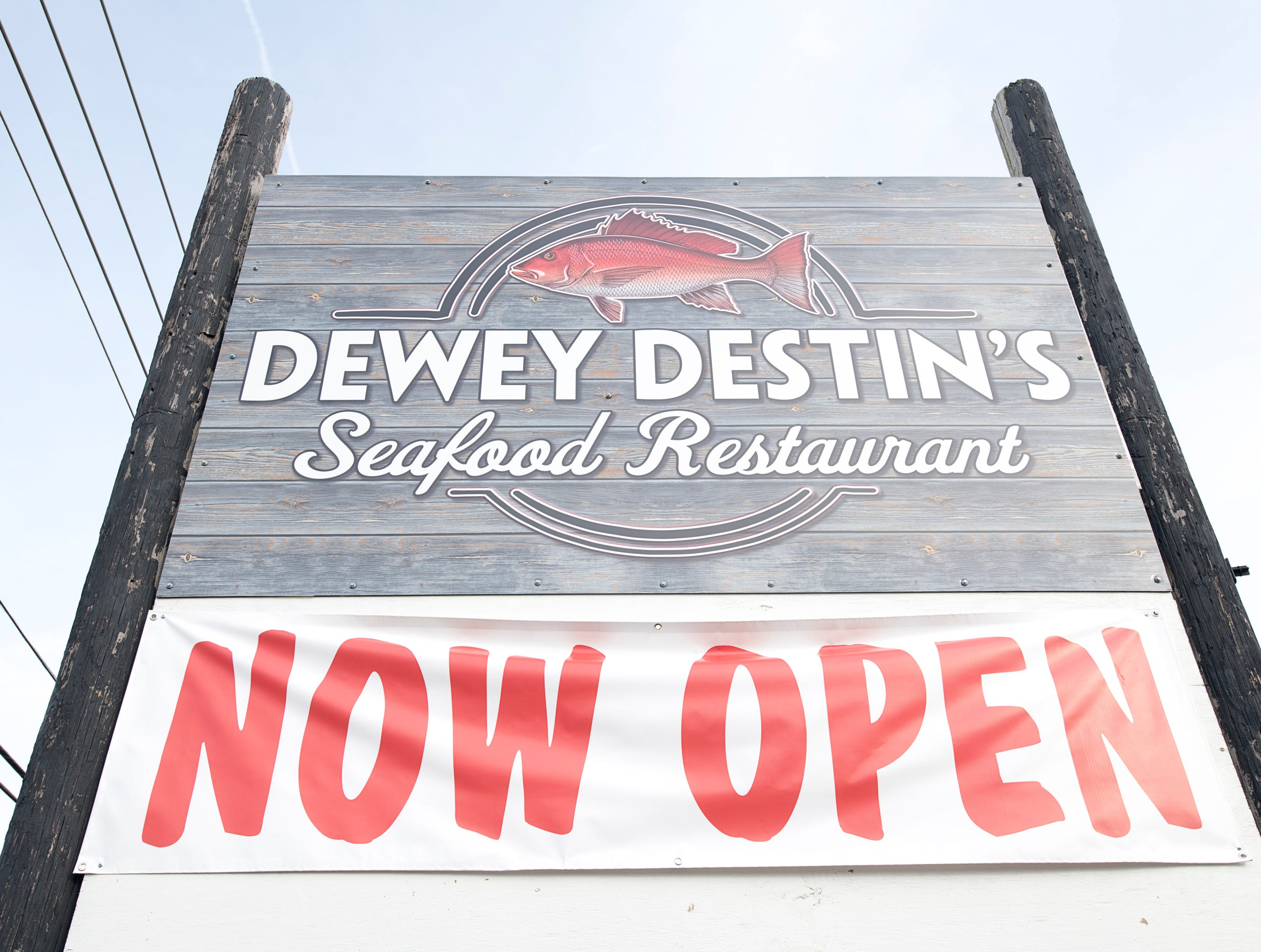 The sign lets the public know that the new Dewey Destin Seafood Restaurant is now open in Navarre on Thursday, November 29, 2018.