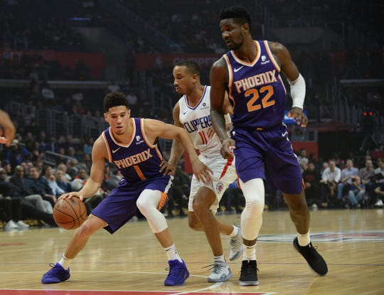 Suns guard Devin Booker tries to get rookie center Deandre Ayton involved in a play during a game Nov. 28 against the Clippers at Staples Center.