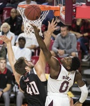 Arizona State University's Luguentz Dort goes for a rebound against Omaha's Matt Pile during the first half of their game in Tempe, Wednesday, Nov.28,  2018. Darryl Webb/Special for the Republic