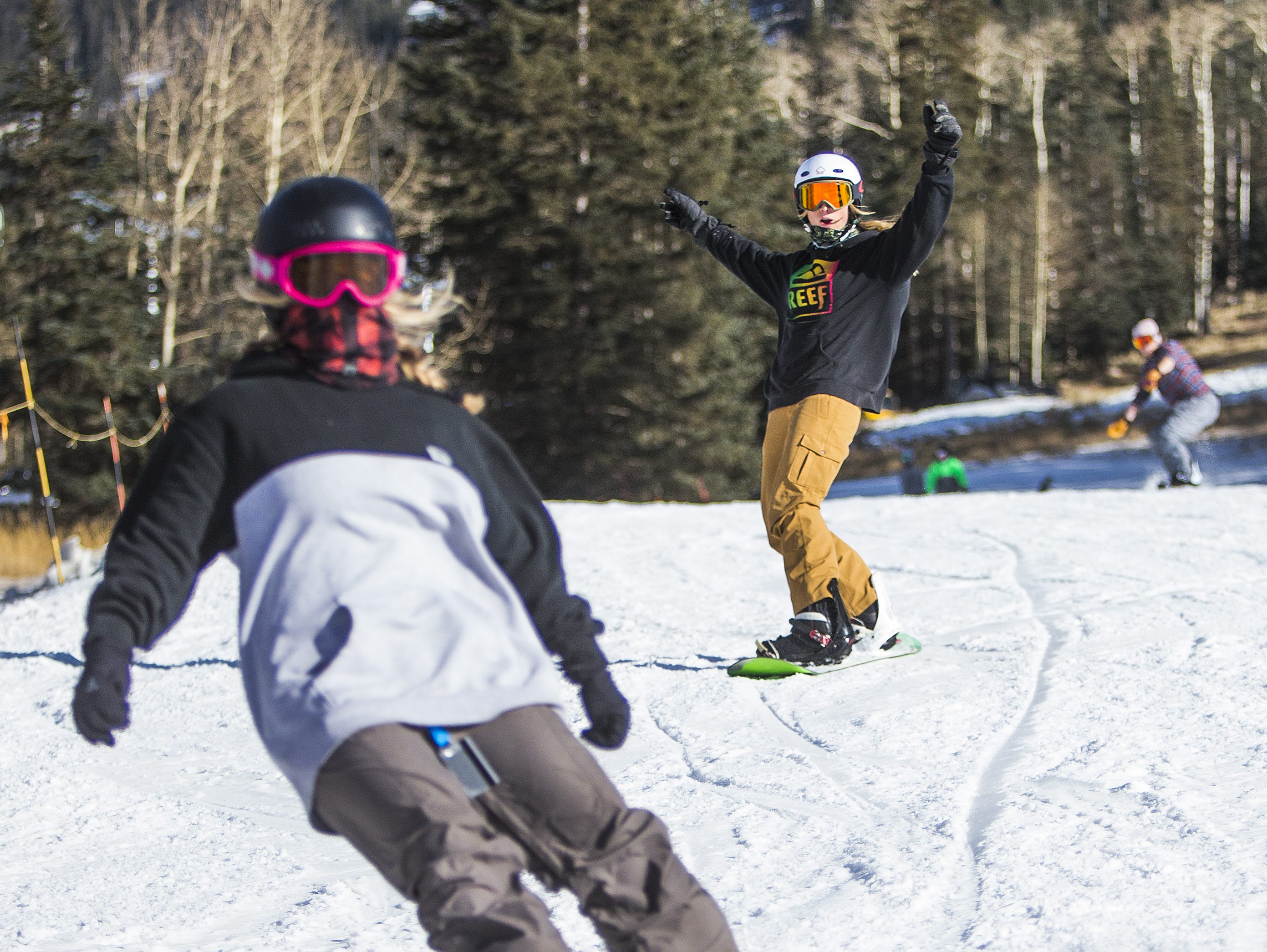 Lindsey Glastetter (left), 19, of Orange, California, and Nikki Young, 19, of San Jose, California, finish a run at Arizona Snowbowl in Flagstaff Nov. 28, 2018.  Both are Northern Arizona University students.