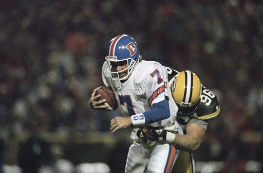 Broncos quarterback John Elway is sacked by Packers linebacker Shawn Patterson on Sunday, Oct. 10, 1993, in Green Bay.