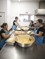 Workers make some of the tamales in the kitchen at the Tamale Store in Phoenix, Ariz. on November 26, 2018.