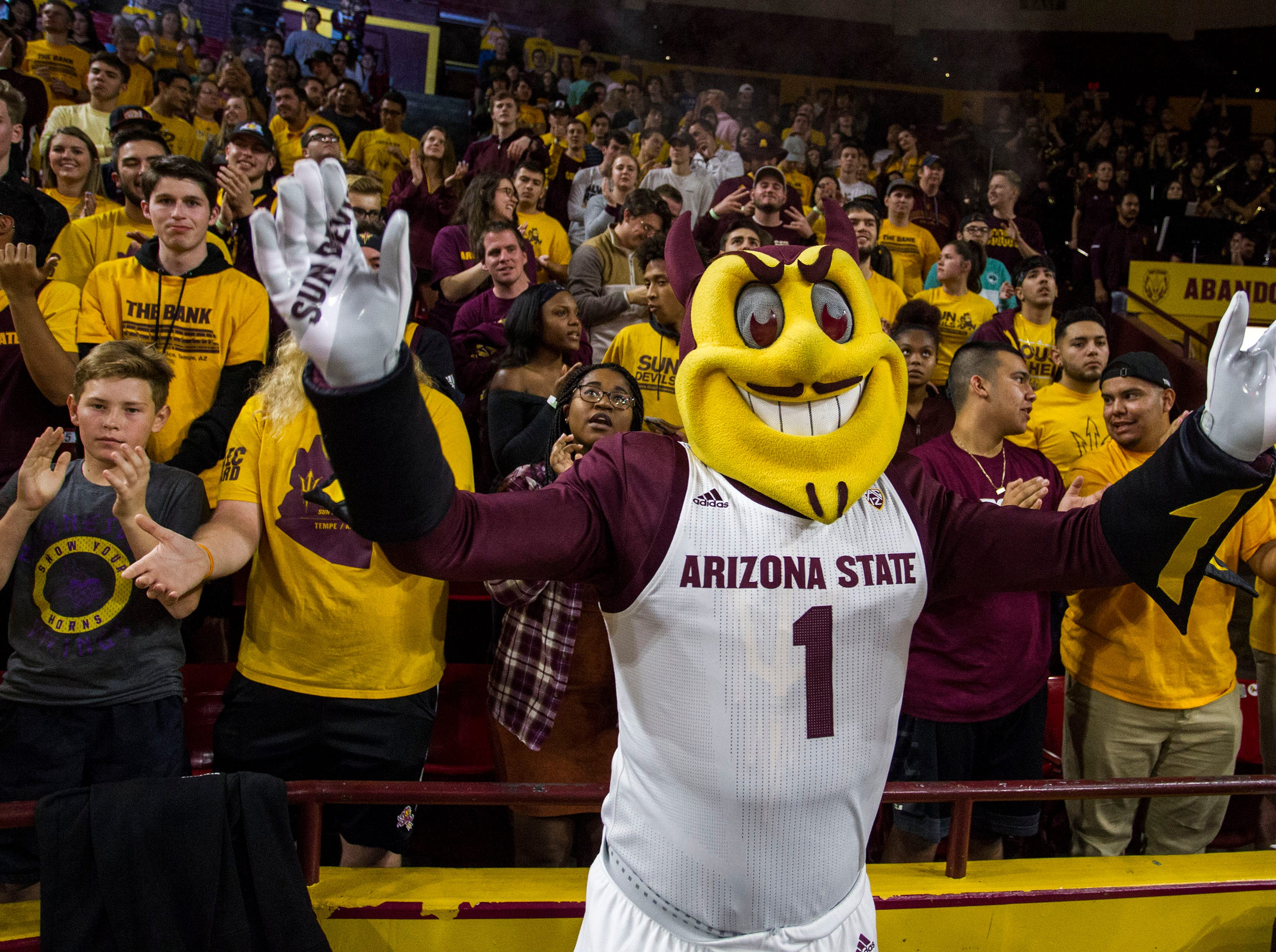 Arizona State University's mascot Sparky leads the student section during the first half of their game with Nebraska Omaha in Tempe, Wednesday, Nov.28,  2018. Darryl Webb/Special for the Republic