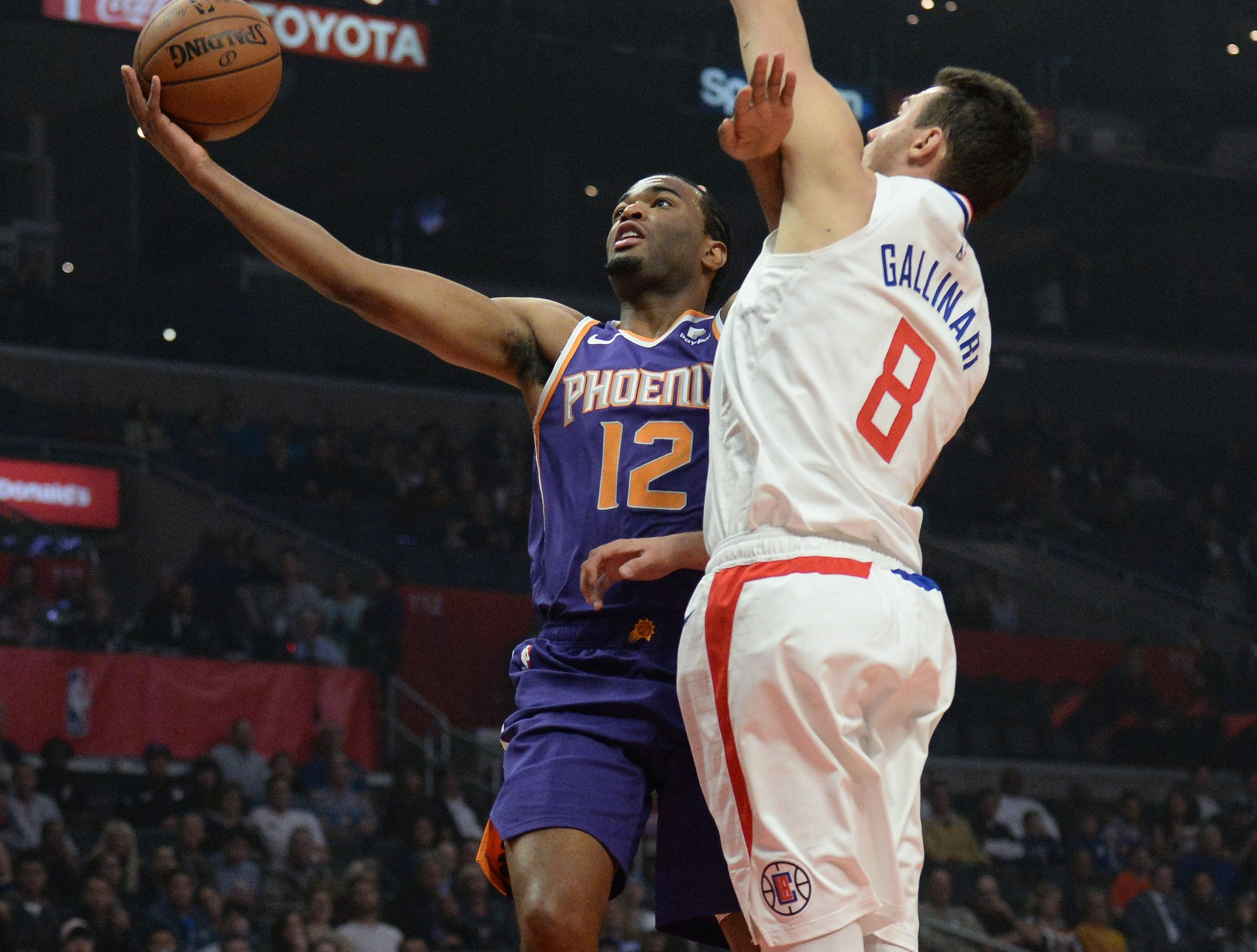 November 28, 2018; Los Angeles, CA, USA; Phoenix Suns forward T.J. Warren (12) moves in to score a basket against Los Angeles Clippers forward Danilo Gallinari (8) during the first half at Staples Center. Mandatory Credit: Gary A. Vasquez-USA TODAY Sports