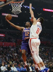 TJ Warren gets to the rim against Clippers forward Danilo Gallinari during the first half of a game Wednesday at Staples Center.