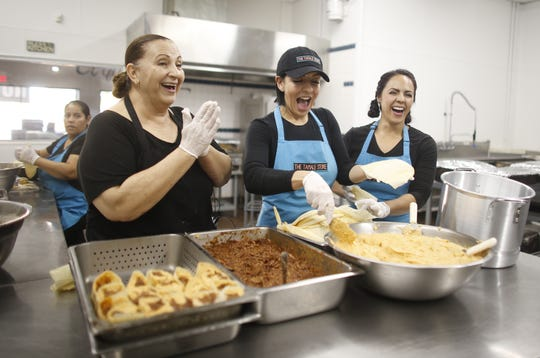 Martha Castillo and her daughters Pauline Pimienta (center) and Maria Stanzak (R) make some tamales in the kitchen at the Tamale Store in Phoenix, Ariz. on November 26, 2018.