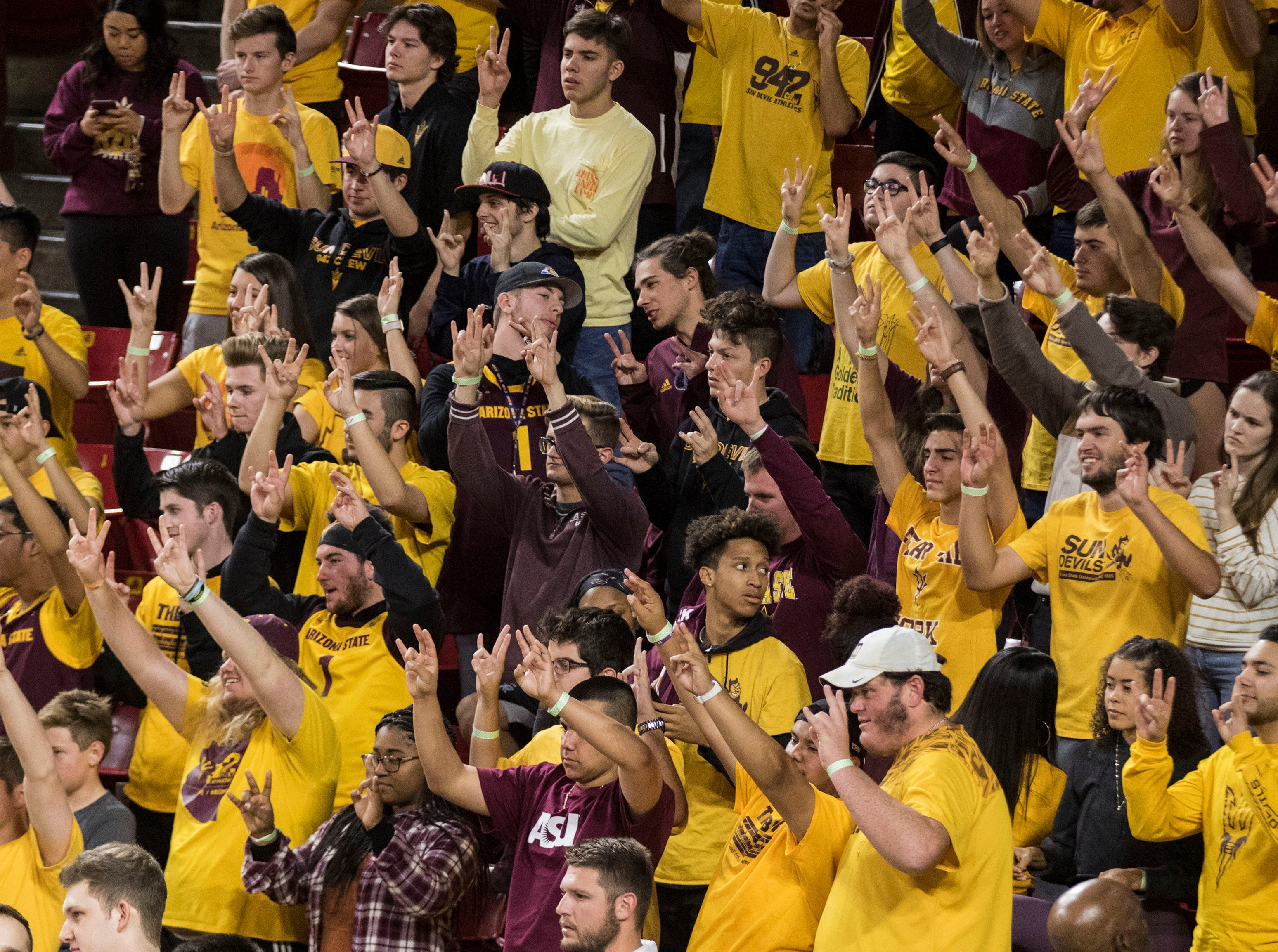 Arizona State University's student body does Devils' Up against Nebraska Omaha during the first half of their game in Tempe, Wednesday, Nov.28,  2018. Darryl Webb/Special for the Republic
