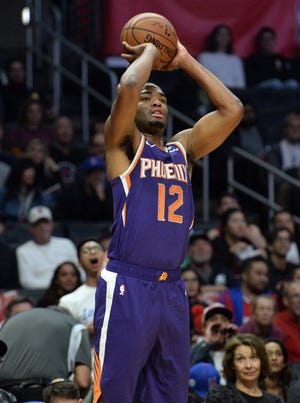 November 28, 2018; Los Angeles, CA, USA; Phoenix Suns forward T.J. Warren (12) shoots against the Los Angeles Clippers during the first half at Staples Center. Mandatory Credit: Gary A. Vasquez-USA TODAY Sports
