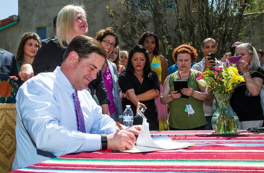 Gov. Doug Ducey signs Senate Bill 1350 that ensures that Arizonans can use homesharing services like Airbnb and HomeAway without over regulation by the government, Jun. 1, 2016.
