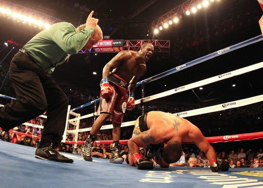 Deontay Wilder taunts Eric Molina after knocking him to the ground during a World Boxing Championship fight June 13, 2013.