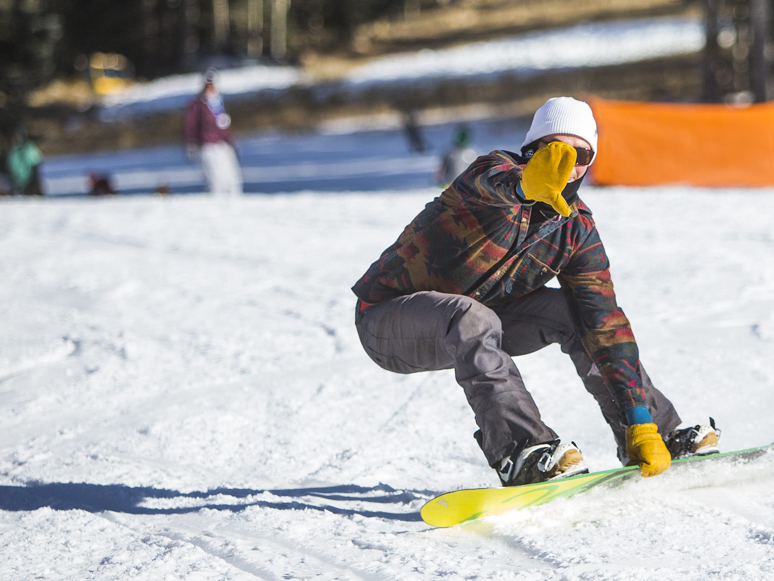 A snowboarder finishes his run at Arizona Snowbowl in Flagstaff, Wednesday, November 28, 2018.