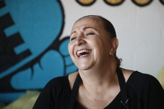 Martha Castillo laughs inside the Tamale Store in Phoenix, Ariz. on November 26, 2018.