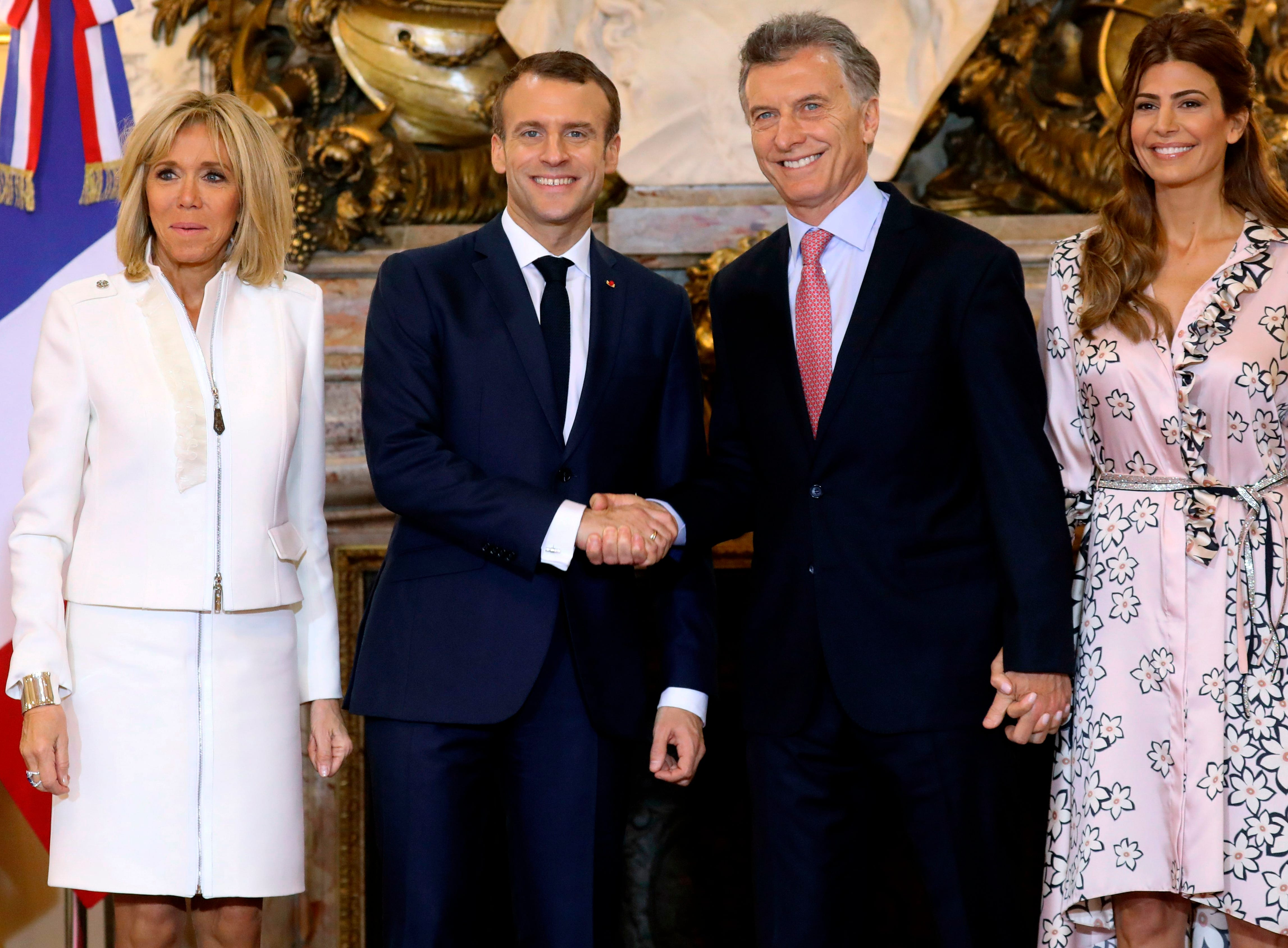 France's President Emmanuel Macron (2nd L) shakes hands with Argentina's President Mauricio Macri next to France's First Lady Brigitte Macron and Argentina's First Lady Juliana Awada (C) at the Casa Rosada presidential palace in Buenos Aires, on November 29, 2018, on the eve of the G20 Leaders' Summit. - Global leaders gather in the Argentine capital for a two-day G20 summit beginning on Friday likely to be dominated by simmering international tensions over trade. (Photo by Ludovic MARIN / AFP)        (Photo credit should read LUDOVIC MARIN/AFP/Getty Images)