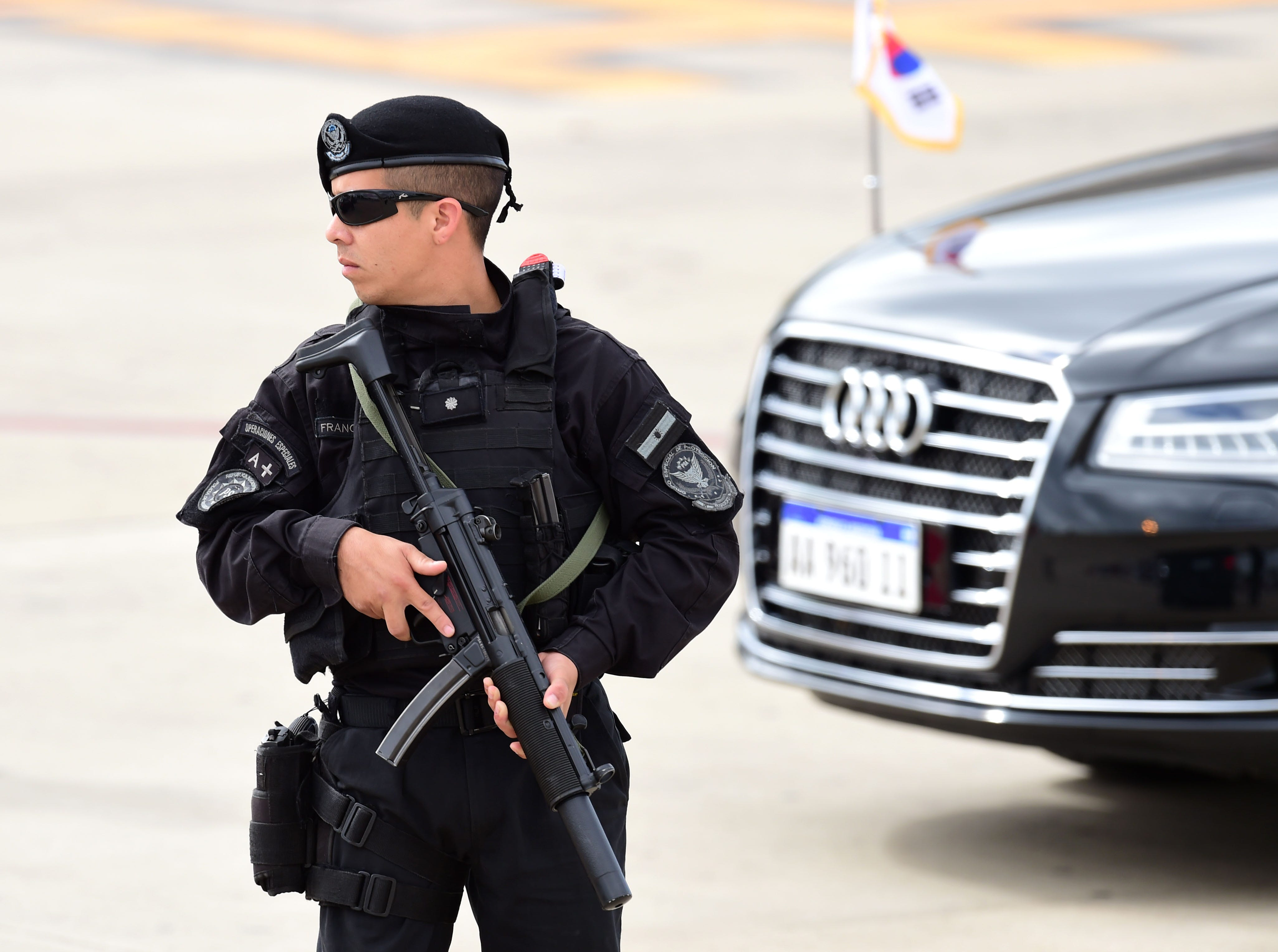 An Argentinian police special operations officer stands guard before the arrival of South Korea's President Moon Jae-in at Ezeiza International airport in Buenos Aires province, on November 29, 2018. - Global leaders gather in the Argentine capital for a two-day G20 summit beginning on Friday likely to be dominated by simmering international tensions over trade. (Photo by Martin BERNETTI / AFP)        (Photo credit should read MARTIN BERNETTI/AFP/Getty Images)