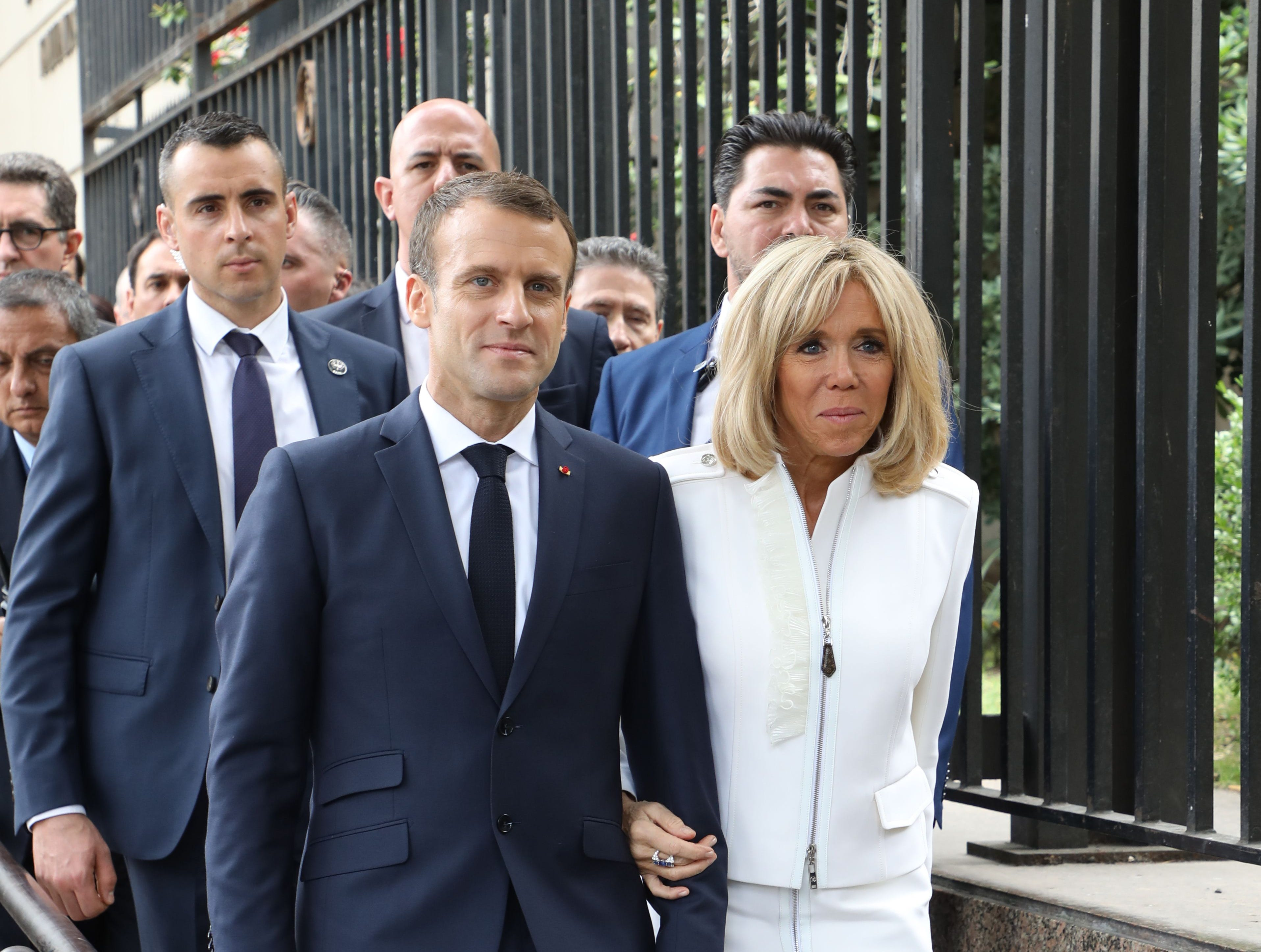 """France's President Emmanuel Macron and France's First Lady Brigitte Macron visit the Metropolitan Cathedral in Buenos Aires on November 29, 2018. - Macron arrived on the eve for a two-day G20 summit beginning on November 30 likely to be dominated by simmering international tensions over trade. In an interview with Argentine daily La Nacion, he warned against the risk of """"a destructive trade war for all"""" emanating from the G20 discussions. (Photo by Ludovic MARIN / AFP)        (Photo credit should read LUDOVIC MARIN/AFP/Getty Images)"""