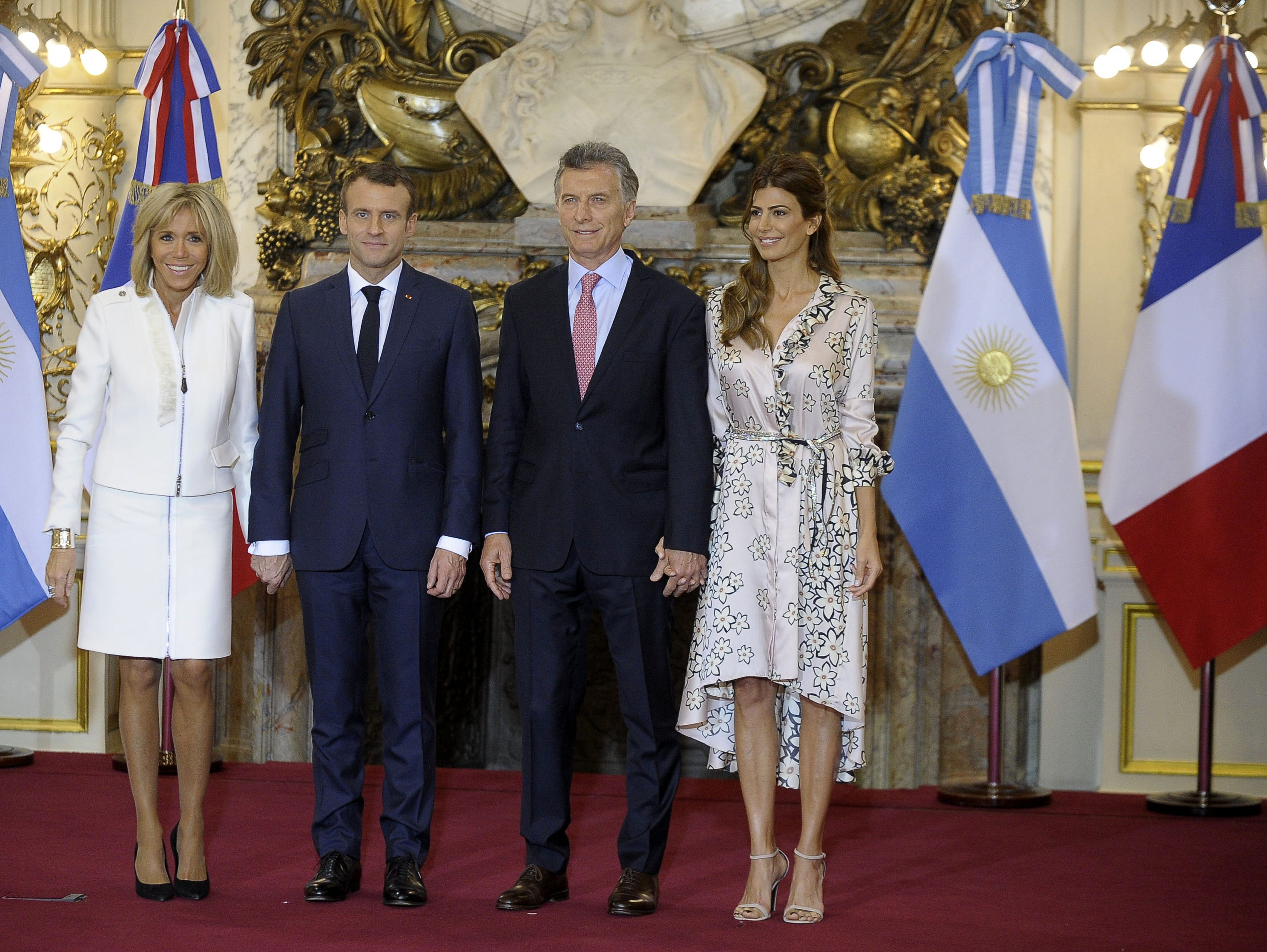 France's President Emmanuel Macron (2-L) and Argentina's President Mauricio Macri (2-R) pose for pictures flanked by their wives Brigitte Macron (L), and Juliana Awada respectively, during a welcome ceremony at the Casa Rosada presidential palace in Buenos Aires, on November 29, 2018, on the eve of the G20 Leaders' Summit. - Global leaders gather in the Argentine capital for a two-day G20 summit beginning on Friday likely to be dominated by simmering international tensions over trade. (Photo by Javier Gonzalez TOLEDO / AFP)        (Photo credit should read JAVIER GONZALEZ TOLEDO/AFP/Getty Images)