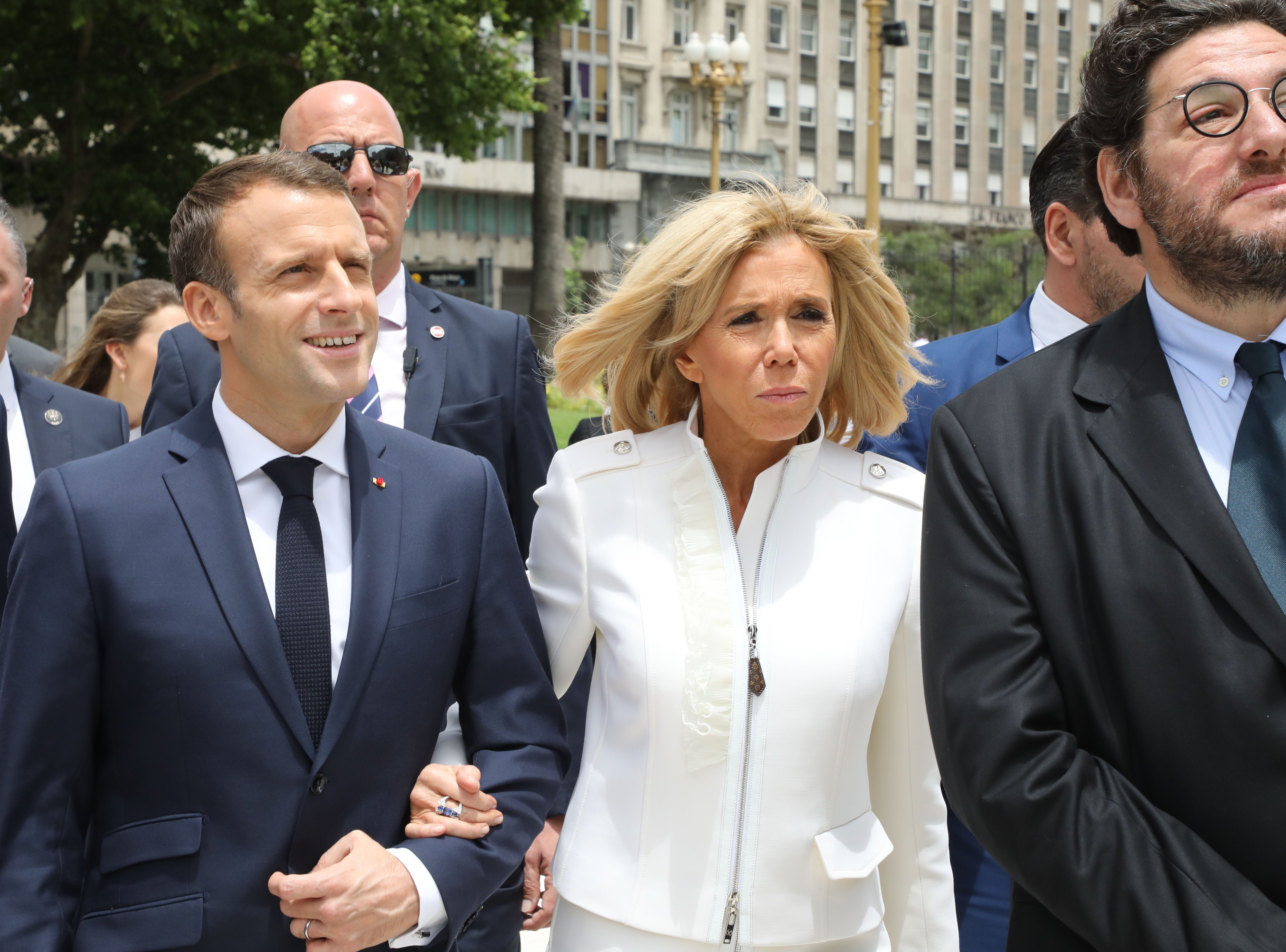 """France's President Emmanuel Macron and France's First Lady Brigitte Macron visit Plaza de Mayo in Buenos Aires on November 29, 2018. - Macron arrived on the eve for a two-day G20 summit beginning on November 30 likely to be dominated by simmering international tensions over trade. In an interview with Argentine daily La Nacion, he warned against the risk of """"a destructive trade war for all"""" emanating from the G20 discussions. (Photo by Ludovic MARIN / POOL / AFP)        (Photo credit should read LUDOVIC MARIN / POOL/AFP/Getty Images)"""
