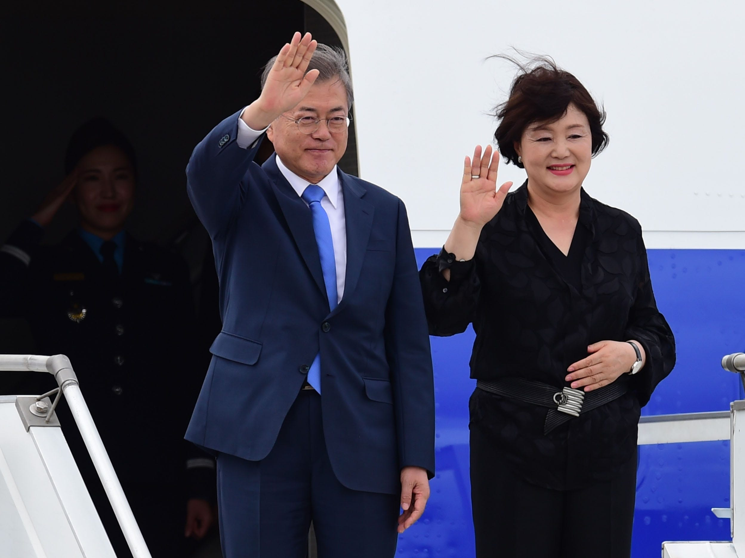 South Korea's President Moon Jae-in  (L) and his wife Kim Jung-sook, wave upon arrival at Ezeiza International airport in Buenos Aires province, on November 29, 2018. - Global leaders gather in the Argentine capital for a two-day G20 summit beginning on Friday likely to be dominated by simmering international tensions over trade. (Photo by MARTIN BERNETTI / AFP)        (Photo credit should read MARTIN BERNETTI/AFP/Getty Images)